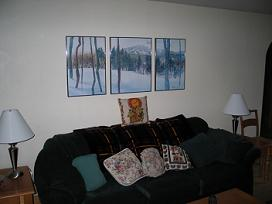 wall painting above couch in living room design