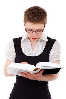 Career woman studying and reading a textbook